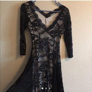 knee-length black & nude v-neck laced dress.